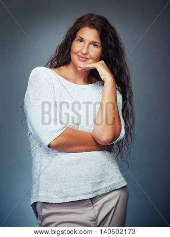 Sophisticated Young Woman Smiling Straight Into Camera