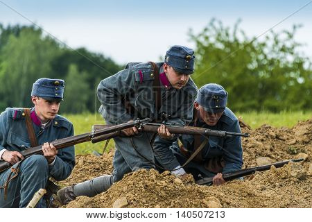 Snina Slovakia - May 28 2016: Military historical reconstruction battles of World War I Karpaty 1914/1916. Participants of the event stand on the attack near Snina Slovakia.