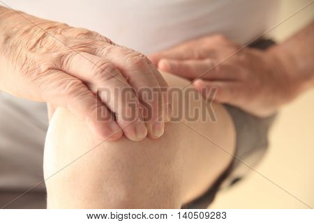 A senior man with a painful knee joint