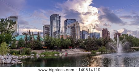 Skyline reflected in the Bow River at princes island park and in Calgary Alberta.