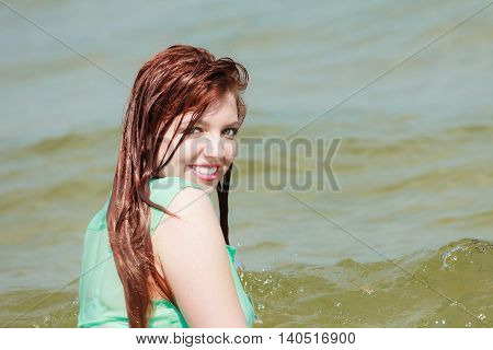 Sensual Girl Wet Cloth In Water On The Coast.