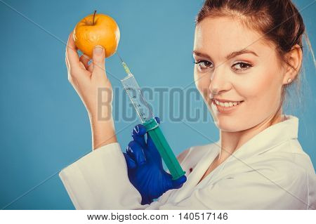 Scientist Doctor Injecting Apple. Gm Food.