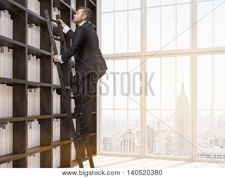 Young man in suit is climbing up ladder in house library. New York city seen through window. Concept of information searching. 3d rendering.