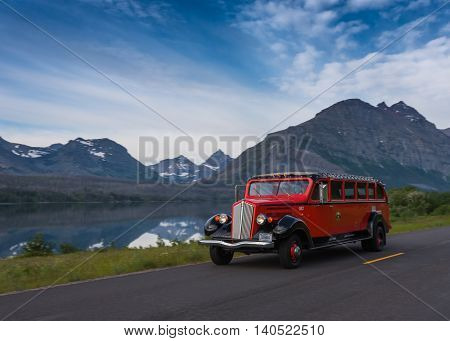 Glacier National Park United States: June 23rd 2016. Red Bus Passes at St Mary Lake before beginning a tour of Glacier National Park