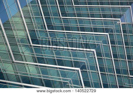 Reflections of blue skies in glass office windows