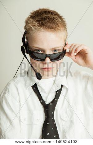 Boy Dressed As Slick Businessman With Head Set