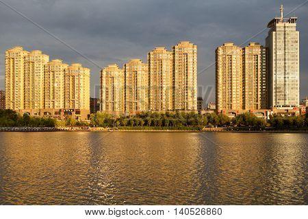 Evening light on buildings above the Nanhu Lake Ürümqi Xinjiang China.