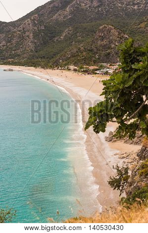 blue sea water and uncrowded beach of Oludeniz in Turkey