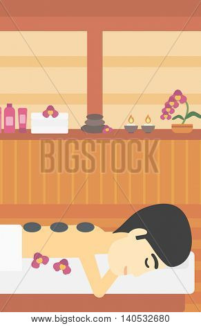 An asian man relaxing while getting stone therapy massage in the spa center. Man having back massage in spa salon. Vector flat design illustration. Vertical layout.