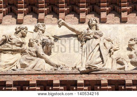 fragment of famous Arc de Triomf frieze in Barcelona Spain