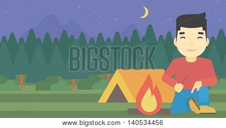 An asian man kindling a campfire on the background of camping site with tent. Tourist relaxing near campfire. Vector flat design illustration. Horizontal layout.