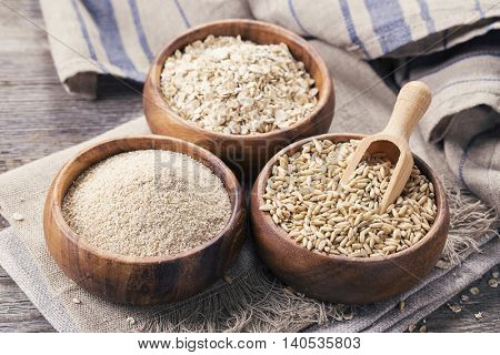 Oat flakes, seeds and bran in bowls