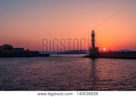 Chania, Crete, Greece: lighthouse in Venetian harbor in the sunset