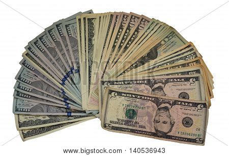 US dollars spread out like a fan isolated on white background