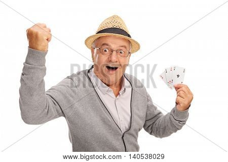 Excited senior showing four aces and looking at the camera isolated on white background
