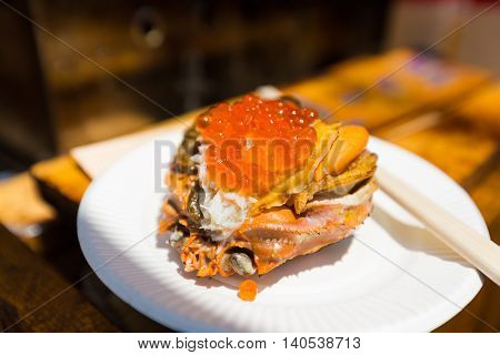 Seafood mix containing scallop oyster fish eggs crab flake and crab brain sold at Tsukiji Fish Market in Tokyo Jaoan