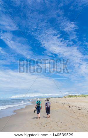 Kijkduin the Netherlands - July 13 2016: senior couple walking on the beach