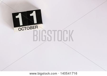 October 11th. Day 11 of month wooden color calendar on white background. Autumn concept. Empty space for text.