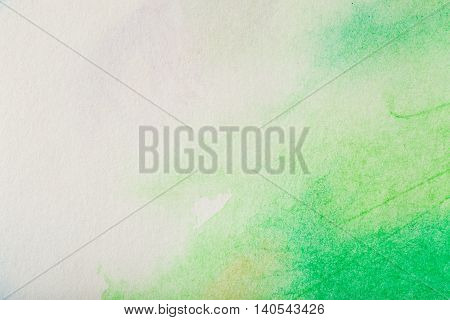 Abstract colorful watercolor paint with green color and paper texture