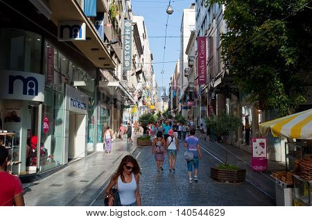 ATHENS-AUGUST 22: Shopping on Ermou Street and various stores on August 22 2014 in Athens Greece. Ermou street is a main shopping street in Athens.