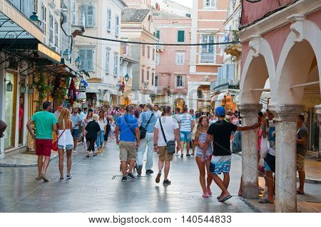 CORFU-AUGUST 22: Kerkyra old town with the row of souvenirs shops on August 22 2014 on Corfu island Greece.