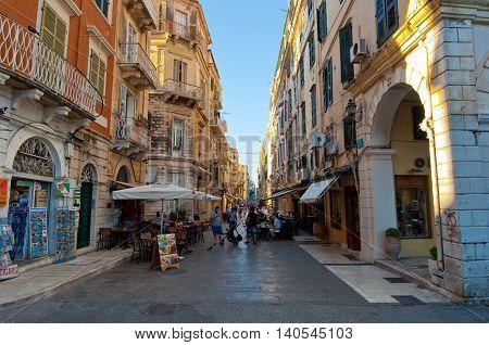 CORFU-AUGUST 24: Tourists go shopping on Corfu island on August 242014 in Kerkyra town. Corfu is a Greek island in the Ionian Sea.