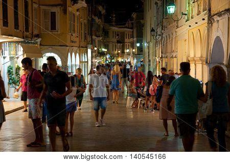 CORFU-AUGUST 25: Tourists walk on night Kerkyra on August 25 2014 in Kerkyra town on the Corfu island Greece.