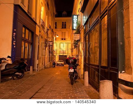 PARIS-AUGUST 16: Parisian street at night in the Latin Quartier on August 162014 in Paris France. The Latin Quarter of Paris is an area in the 5th and the 6th arrondissements of Paris.