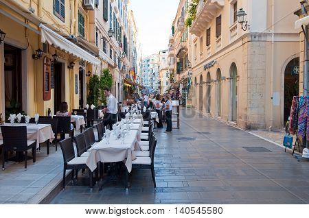 CORFU-AUGUST 22: Kerkyra city local restaurants invite tourists to have a meal on August 22 2014 on Corfu island Greece.