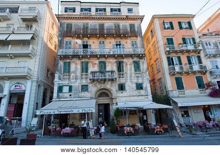 CORFU-AUGUST 27: Venetian Kerkyra city with the row of local restaurants on August 27 2014 on Corfu island Greece.