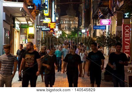 ATHENS-AUGUST 22: Ermou street at night in Plaka area near to Monastiraki Square on August 22 2014 in Athens Greece. Ermou street is the shopping street in Athens. Greece.
