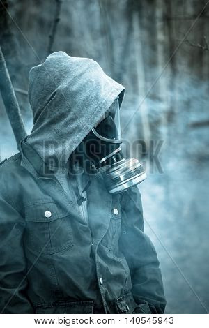 Teenager With Hooded Jacket And Gas Mask