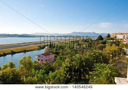 The runway across the Chalikiopoulou Lagoon as seen from the hilltop of Kanoni on the island of Corfu Greece.