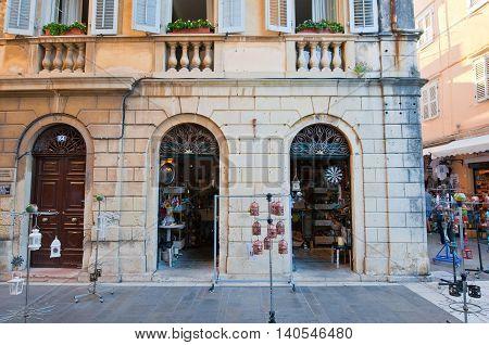 CORFU-AUGUST 27: Venetian Kerkyra city with the row of souvenirs shops on August 27 2014 on Corfu island Greece.