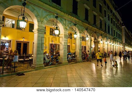 CORFU-AUGUST 22: The Liston of Corfu at night in Kerkyra city with the row of local restaurants on August 22 2014 on Corfu island Greece.