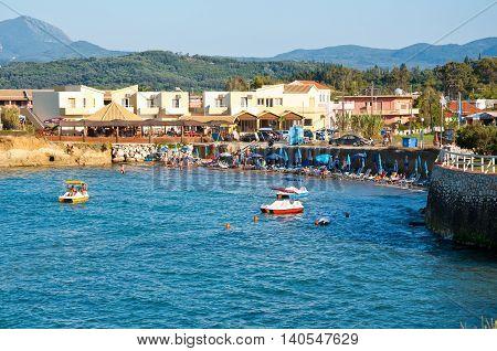 CORFU-AUGUST 26: Sidary resort people sunbath on the sandy beach on August 262014 on the Corfu island Greece.