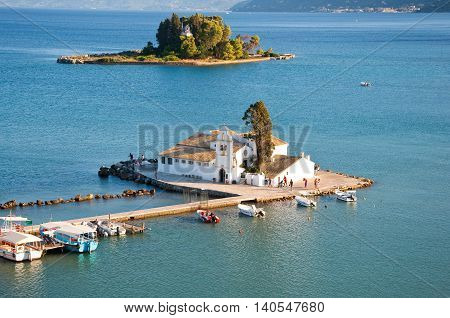 Vlacheraina monastery as seen from Kanoni on the Chalikiopoulou Lagoon on the island of Corfu Greece.