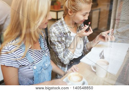 Warm Shot Of Simple Girls In Casual Clothes Doing Make-up. Friends Meet Together To Have Fun, Drink