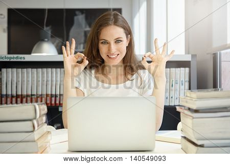 Cheerful Student Girl, Happy With Completed Work, Showing Ok Gesture With Both Hands, Smiling And Lo