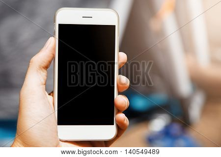 Nice Close-up Shot Of Modern Gadget In Hand On Blur Background. Beautiful Phone With Laconic Design