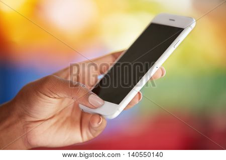 Young African Female Student Holding Smart Phone With Blank Copy Space For Your Promotional Content,