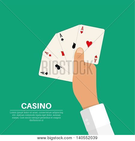 The hand holding four playing cards aces of all colors. Symbolizes a combination of