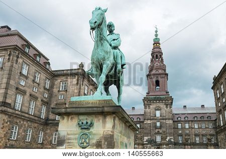 Copenhagen upward view of the Chrisrianborg palace with the monument of King Cristian IX in the foreground poster