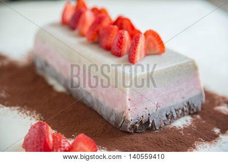 Neapolitan Ice Cream Cake with fresh strawberries