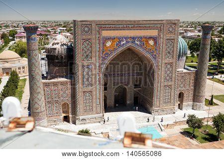 View of Sher-Dor Madrasa from Ulugbek Madrasa Registan Square Samarkand Uzbekistan.
