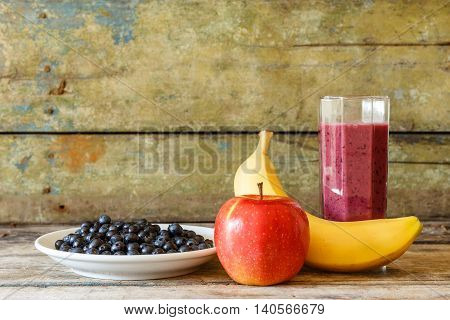 Glass Of Fresh Smoothie With Ingredients Around
