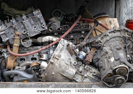 Pile of Scrap Metal Engines and Car Parts
