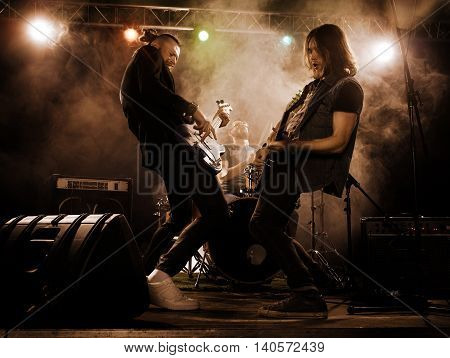 Rock Band Performs On Stage.