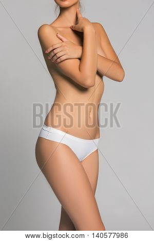 Beautiful young woman with clean skin nude topless breasts. Beauty lady covering her nude breast. poster
