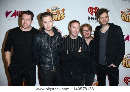 NEW YORK-DEC 12: (L-R) Zach Filkins, Ryan Tedder, Eddie Fisher, Drew Brown & Brent Kutzle of OneRepublic attend Z100's Jingle Ball 2014 at Madison Square Garden on December 12, 2014 in New York City.